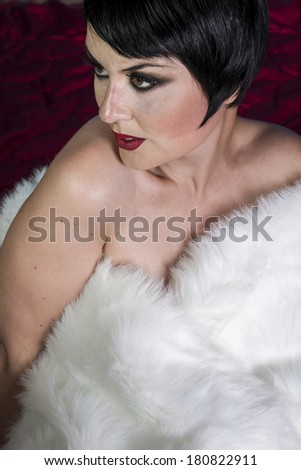 Sexy brunette woman dressed in 20s style - stock photo