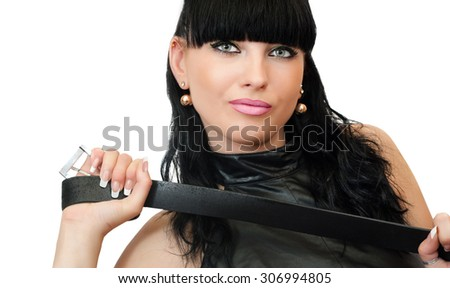 Sexy brunette woman holding whip or a strap on a white background - stock photo
