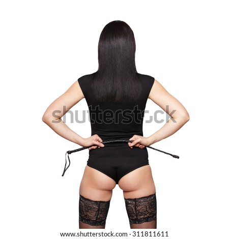 Sexy brunette woman in stockings holding whip, back view, isolated on white - stock photo