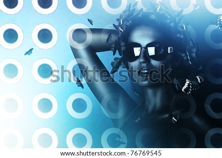 sexy brunette woman in sunglasses and hologram
