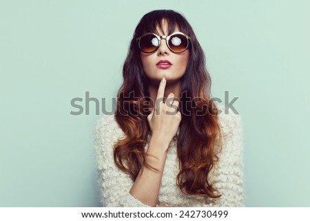 Sexy brunette woman in sweater with sunglasses. Ombre hair - stock photo