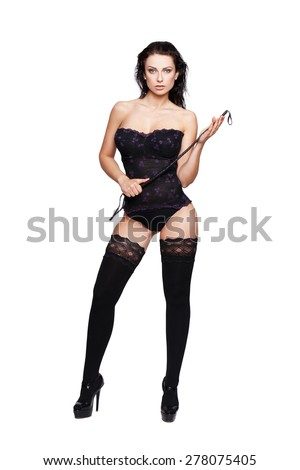 Sexy brunette woman in underwear with wet hair and whip, bdsm, isolated - stock photo