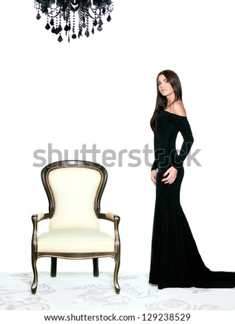 sexy brunette woman near the chair - stock photo