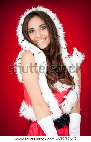 sexy brunette woman posing in santa costume - stock photo