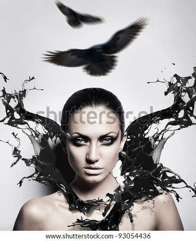 sexy brunette woman with black splash and crows - stock photo