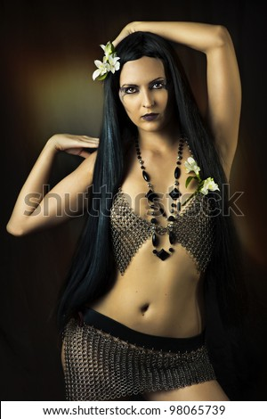 Sexy brunette woman with long healthy hair and creative make up - stock photo