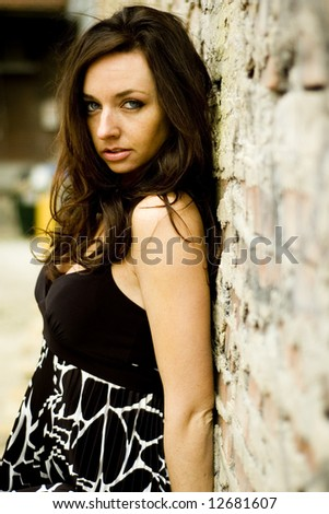 Sexy brunette young woman in casual clothes