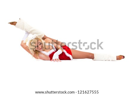 Sexy bunny girl makes splits against isolated white background - stock photo