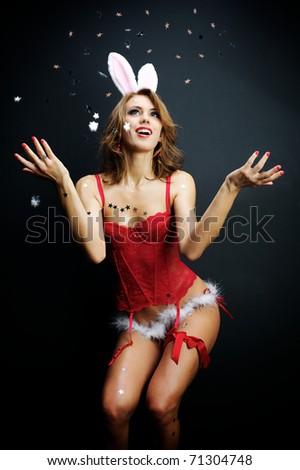 Sexy bunny girl with confetti - stock photo