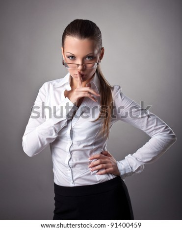 Sexy business woman silence sign - stock photo