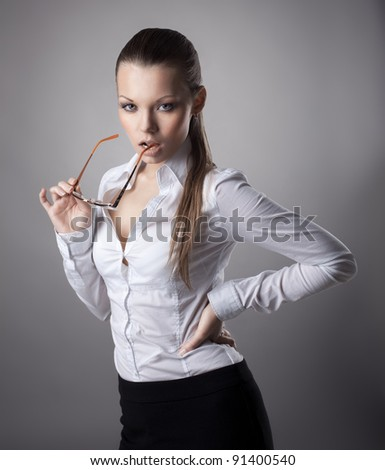 Sexy business woman take glasses off - stock photo