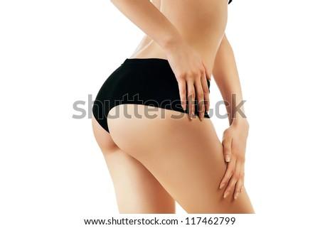 sexy buttocks of slim woman on white background - stock photo