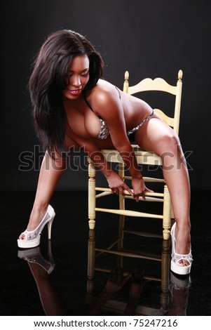Sexy caribbean girl on a chair - stock photo