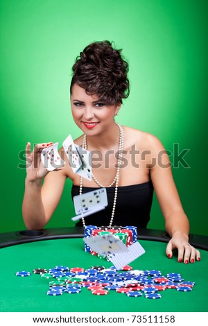 sexy casino woman playing with the cards, over green