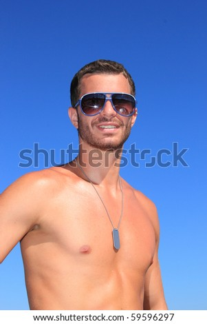 sexy caucasian fit man posing in a beach - stock photo