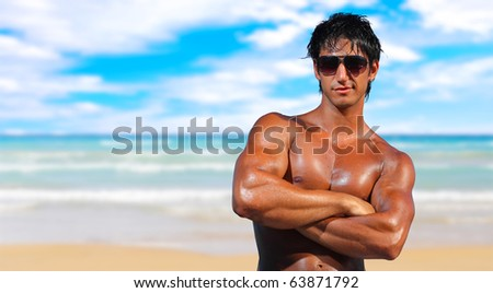 sexy caucasian fit man posing in a beach