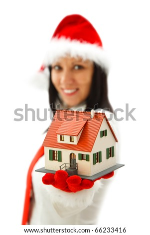Sexy Christmas woman offering a toy house to us