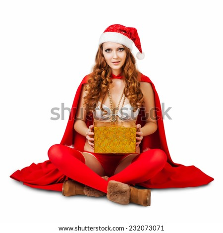 Sexy christmas woman wearing  bikini and red santa claus hat holding gift boxes isolated on white background, studio shot - stock photo