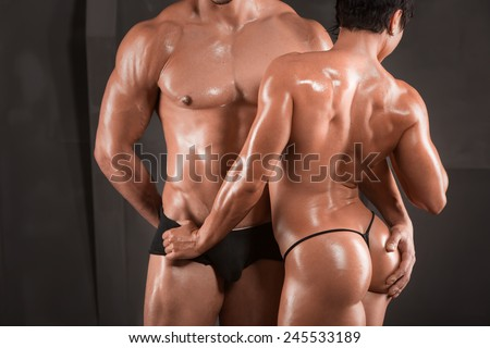 Sexy couple athletes. Athletic man and woman after fitness exercise - stock photo
