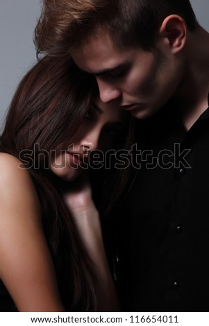 Sexy couple, beautiful young female and male faces closeup, studio shot - stock photo
