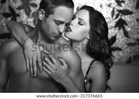 Sexy couple foreplay at night, black and white
