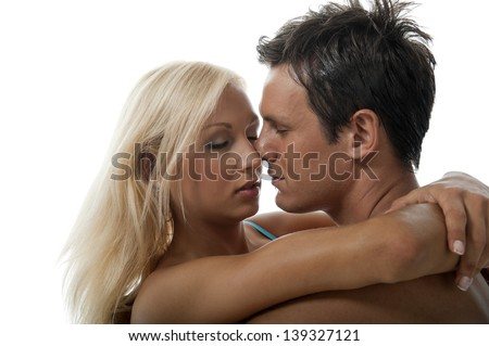 Sexy couple giving each other a tender kiss. - stock photo
