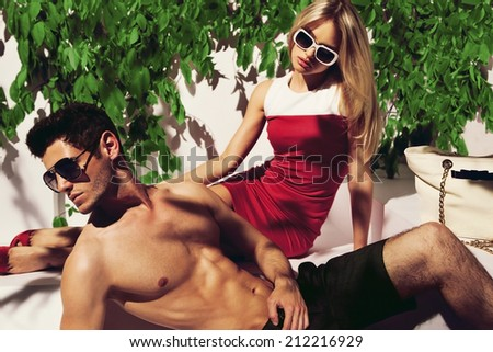 Sexy couple in colors - stock photo