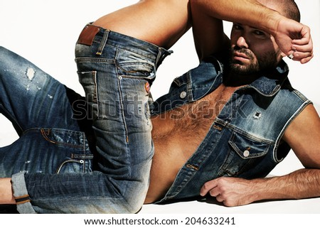 Sexy couple in jeans - stock photo