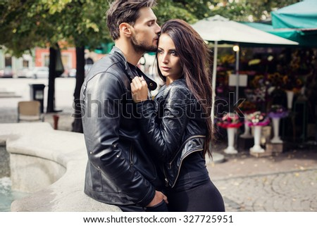 Sexy couple in leather jacket hugging each other - stock photo
