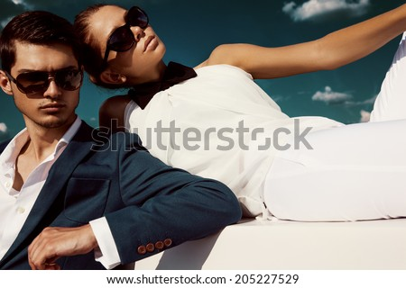 Sexy couple in sunglasses - stock photo
