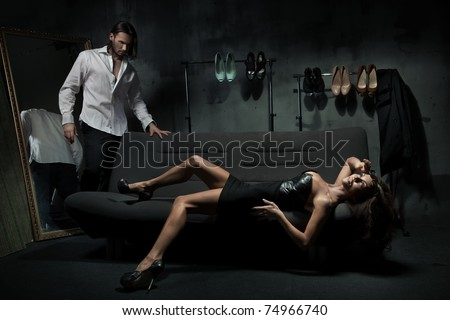 Sexy couple in the bedroom - stock photo