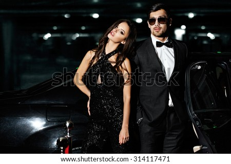 Sexy couple in the car. Hollywood stars. - stock photo