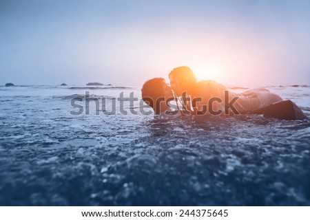 sexy couple in the water - stock photo