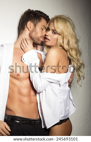 Sexy couple in white shirt - stock photo