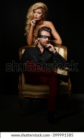 Sexy Couple Love,  Blindfold Man in Suit with sexy blonde woman  - stock photo