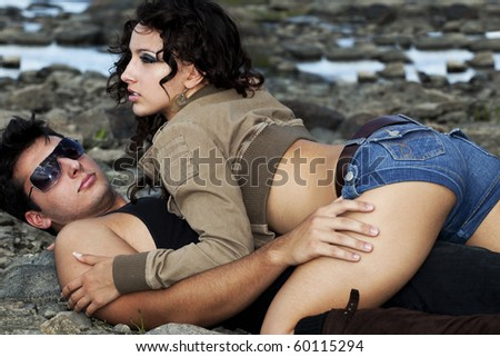 sexy couple lying on the beach - stock photo