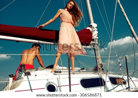 Sexy couple on the boat - stock photo
