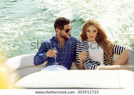 Sexy couple on the luxury boat - stock photo