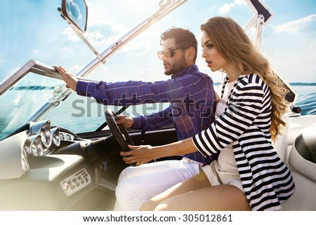 Sexy couple on the luxury yacht - stock photo