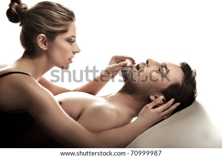 Sexy couple with ice cube - stock photo
