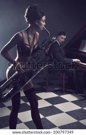 Sexy couple with instruments - stock photo
