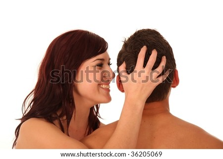 Sexy couple with woman whispering in man's ear