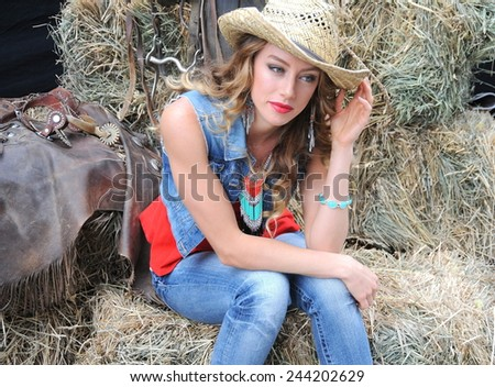 Sexy cowgirl expressions outside. - stock photo
