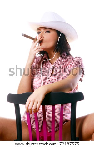 Sexy cowgirl sitting on chair - stock photo
