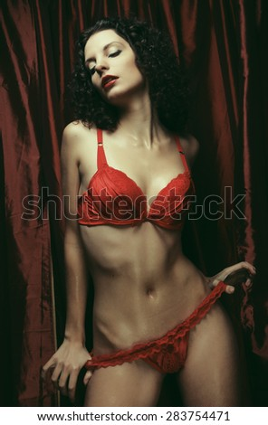 Sexy curly  brunette woman posing in lingerie - stock photo