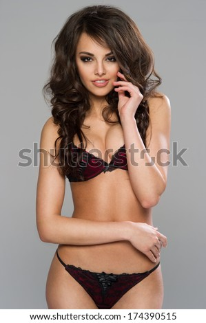 Sexy dark haired woman posing in black lingerie   - stock photo
