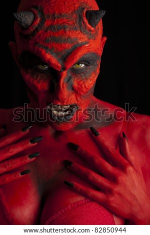 Sexy devil, black background.