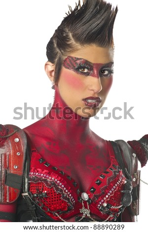 Sexy devil gogo dancer in body paint - stock photo