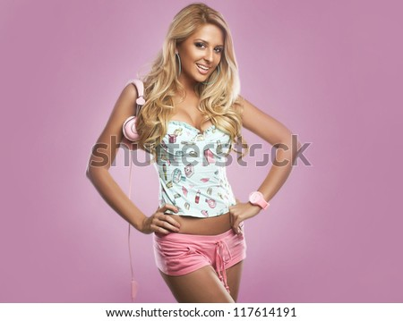 sexy dj woman on pink background - stock photo