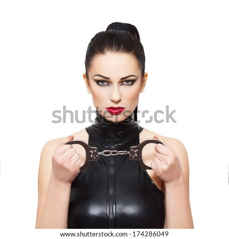 Sexy dominatrix with handcuffs, isolated on white background - stock photo